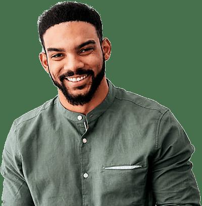 Man in a green shirt smiling