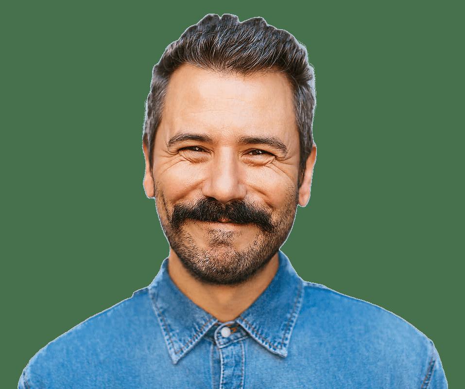 Close up of a man smiling straight at the camera.