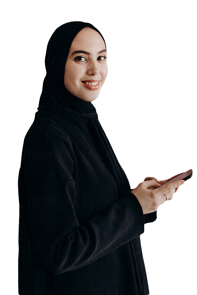 Woman turned to the side smiling straight at the camera while holding a cell phone in both of her hands.