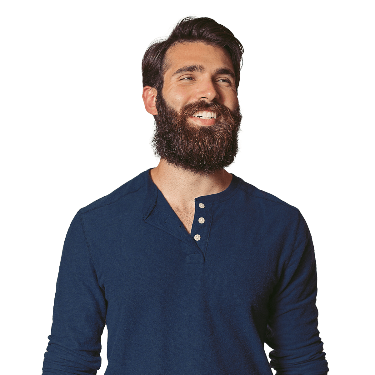 Man in dark blue shirt smiling while looking off to the side.