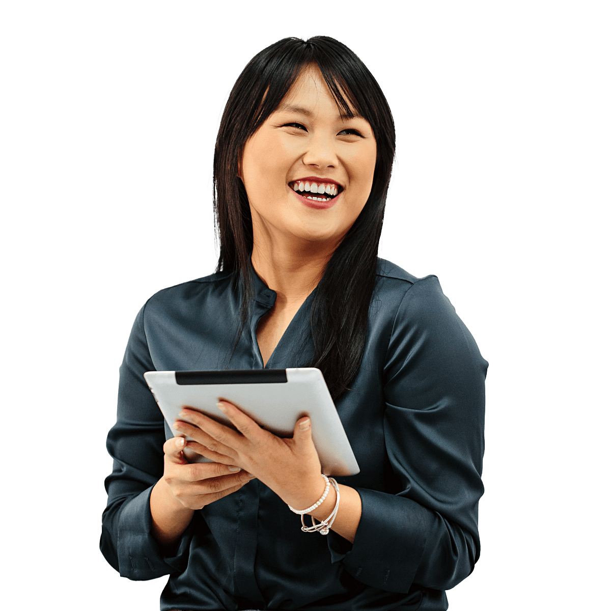 Woman holding an ipad laughing while looking off to the side.