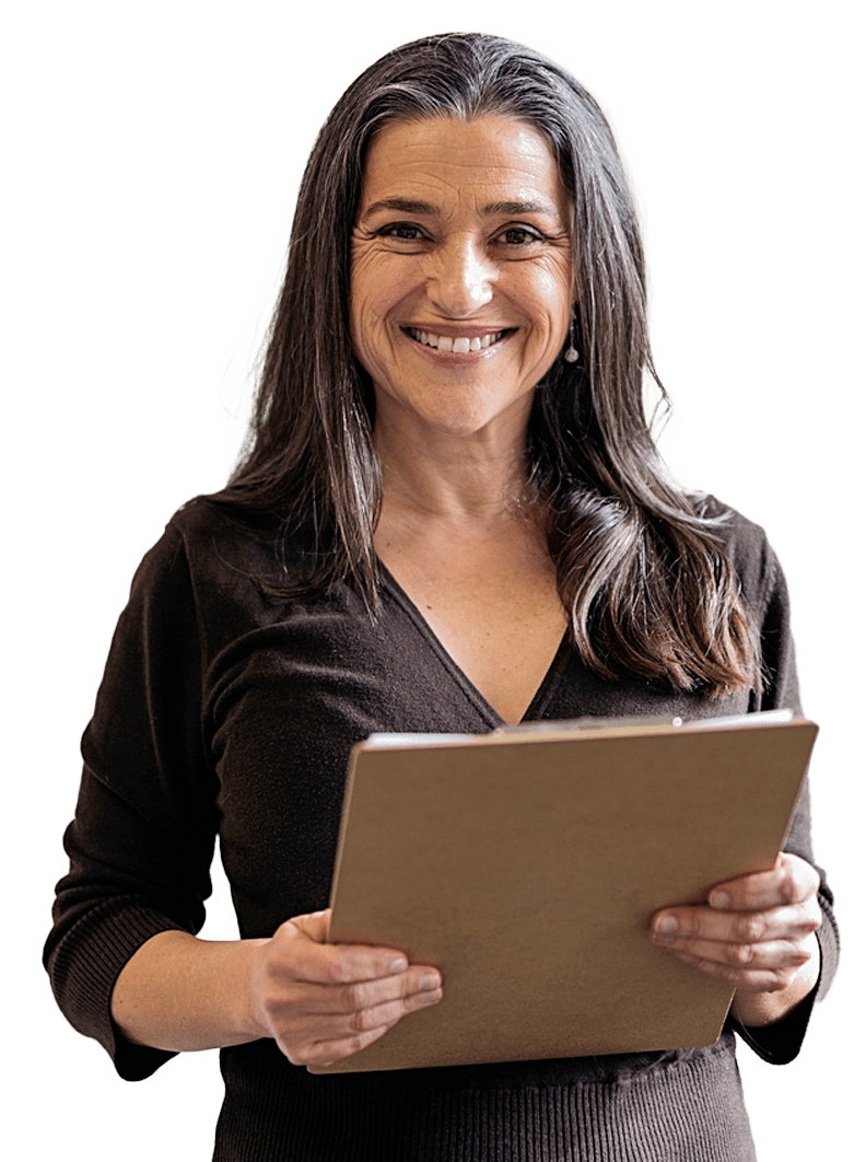 Woman holding a clipboard smiling directly at the camera.