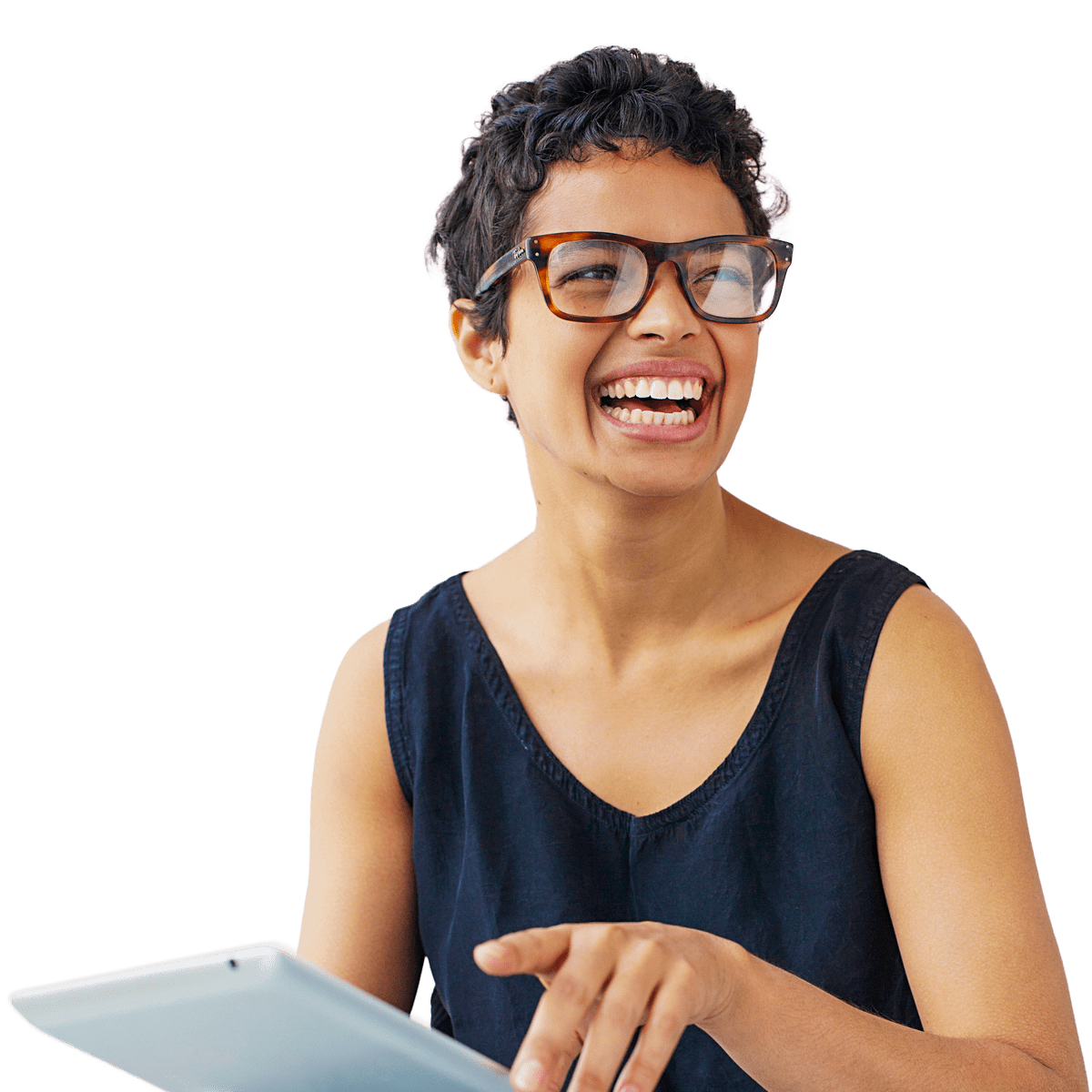 Woman in glasses working on an ipad as she laughs while looking off to the side.